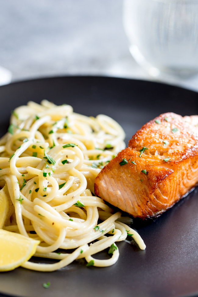 This Pan Seared Salmon with Creamy Lemon Pasta is perfect date night supper. Light yet filling and stunning on the plate. The succulent crisp coral salmon on the creamy white lemon pasta and then the bright grassy parsley. Easy to make and ready in 15 minutes, delicious and beautiful. That is definitely a meal worth staying in for!