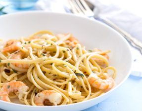 Delicious Garlic Shrimp stirred through pasta spiked with fresh rosemary. This one pot pasta dish is perfect for an elegant mid-week supper. Make it for date night or the next time you have friends for dinner.