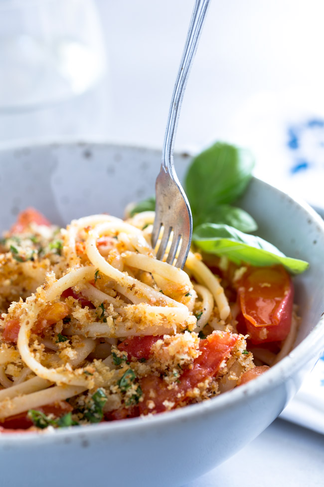 his fresh tomato pasta with basil pangrattato uses a few simple ingredients to make something so delicious. The sauce comes together in the time it takes to cook the pasta, meaning you can have this meal on the table in under 15 minutes!