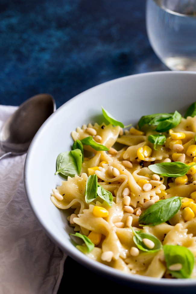 This Summer Pasta with Sweet Corn and Basil is a fresh and quick pasta dish that is perfect for the warmer weather. The pasta is coated in butter and black pepper then tossed through sweet corn and fragrant basil. Finished with creamy and crunchy pine nuts. Just 5 ingredients that sing together and make a dish that will quickly become a firm family favourite.