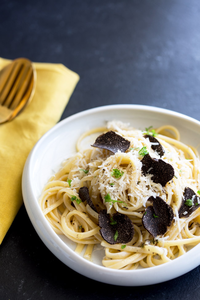 This Black Truffle pasta is a decadent treat for a special date night. The unmistakably earthy rich flavor of black truffle is paired with everything it loves, butter, cheese and perfectly cooked linguine. This is delicious and special meal and is sure to impress!  From Easy Pasta Sauces