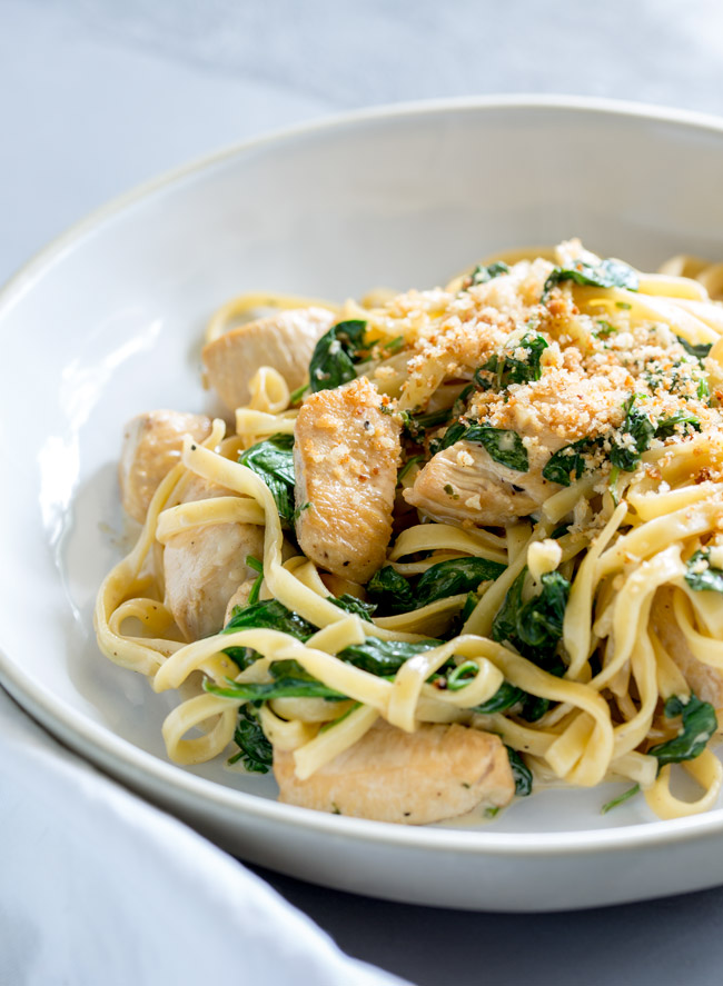 Juicy chunks of chicken, stirred through a creamy spinach and garlic pasta, topped with a salty and crunchy pangrattato. This Chicken Spinach and Garlic Pasta is a great mid-week meal. From Easy Pasta Sauces.