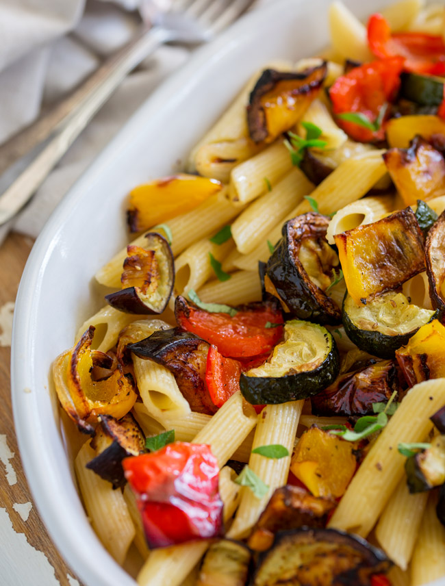 When veg is roasted is becomes sweeter and more intense. So this Mediterranean Pasta with Roasted Vegetables is bright and beautiful and packed with flavor. From Easy Pasta Sauces